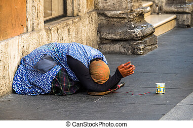 beggar - a beggar on the street. antitheft means red cable