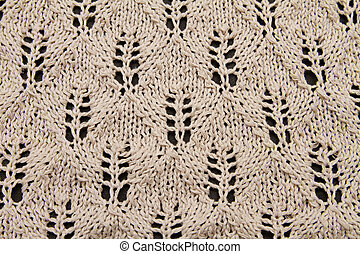 a beige knitted fabric. a close up.