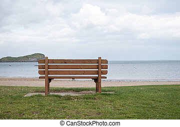 A bench, next to the sea