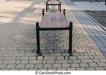 a bench on a pavement in the park
