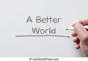 A better world written on whiteboard - Human hand writing a...