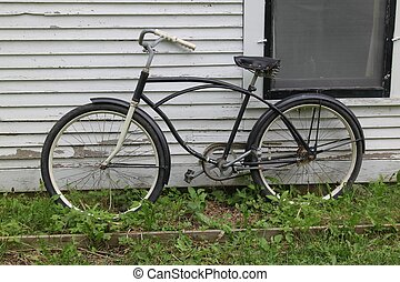 A bicycle leaning against a wall - A bicycle leans against a...