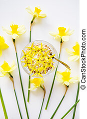 A big bouquet of daffodils and beautiful yellow flowers on the table