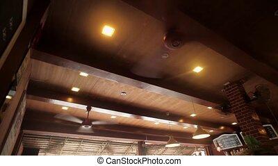 A big cooling ceiling fanin cafe