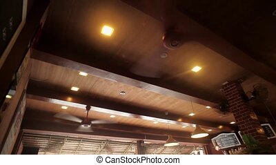 A big cooling ceiling fanin cafe