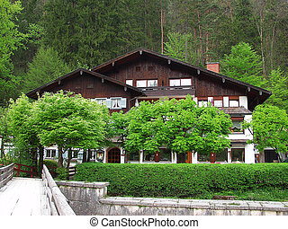 A big house in the alpine village.