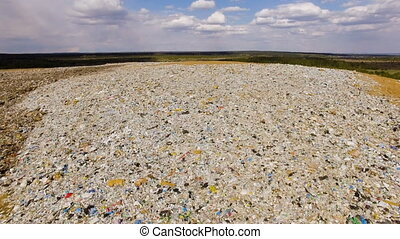 a big mountain of household garbage on the background of...
