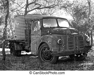 a big old farm truck carrying water