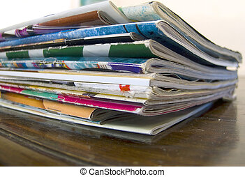 a big pile of old magazines on  the table macro image