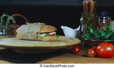A Big Sandwich is Spinning on a Plate