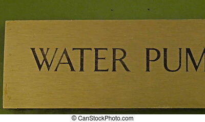 A big signage says Water Pump. It is pasted on the wall with...