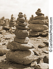 a big stack of stones on beach