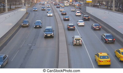 A big traffic of cars, in the evening on city streets.