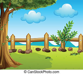 A big tree inside a fence