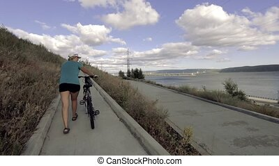 A bike ride to the city promenade. - A girl with a bicycle...