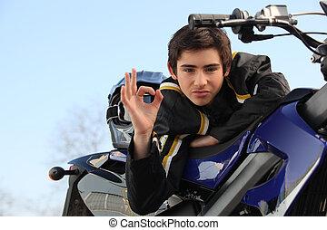 A biker making an ok sign.