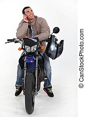 A biker over the phone.