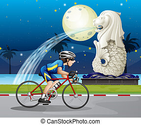 A biker passing the street with the statue of Merlion