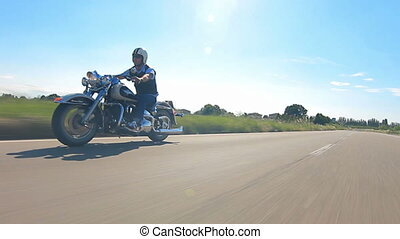 reggello,1/05/2014 motorbike festival, man riding his harley davidson on a highway follow shot car point of view
