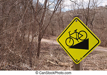 A biking related sign in the woods