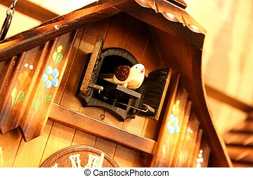 This is a bird come out from a cuckoo clock when it telling the time.