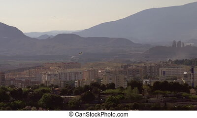 A bird flying over sunny Alicante - A white seagull is...