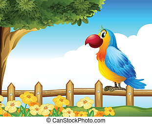A bird standing on a  fence