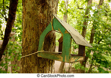 A birdhouse in the park. Homemade bird feeder.