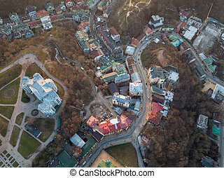 A bird's eye view, aerial view shooting from drone of the Podol district, oldest historical center of Kiev, Ukraine.