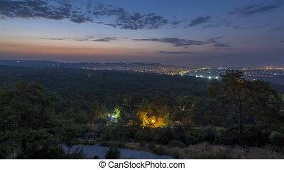 A bird's eye view before sunrise over Antalya night to day...