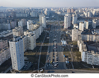 A bird's eye view from drone to the Darnyts'kyi district of Kiev, Ukraine with modern buildings in a spring sunny day.