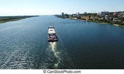 A bird`s eye view of a long barge floating in the Southern...