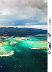 A bird's-eye view of Le Morne Brabant, a UNESCO world heritage site.Coral reef of the island of Mauritius.Storm cloud.