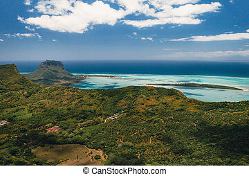 A bird's-eye view of Le Morne Brabant, a UNESCO world heritage site.View of the Sands Chamarel.