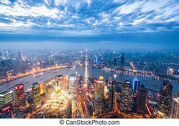 a bird's eye view of magic city of shanghai in nightfall