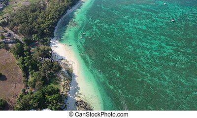 A bird's-eye view of the Mauritius beach opens up.amazing coral reef on the island of Mauritius.Resort