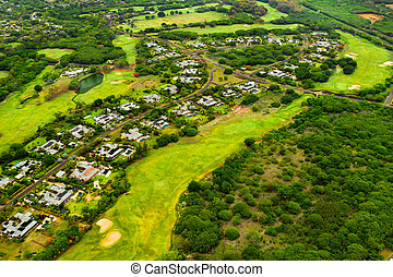 A bird's-eye view of the town and Golf courses on the island of Mauritius.Villas on the island of Mauritius.Golf course