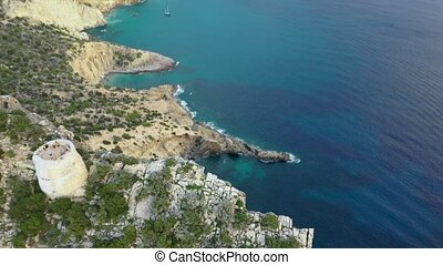 A bird's-eye view of the western cape of Ibiza Island during...