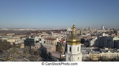 A bird's eye view, panoramic video from the drone in 4K to the golden dome Saint Sophia's Cathedral, Maidan Nezalezhnosti, left bank of city Kiev, Ukraine.