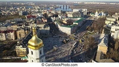 Aerial panoramic video from the drone, bird's eye view to historical famous places in Kiev: Saint Sophia's Cathedral, Sofiyivska Square, left bank of river Dnieper at sunset in the summer. 4K