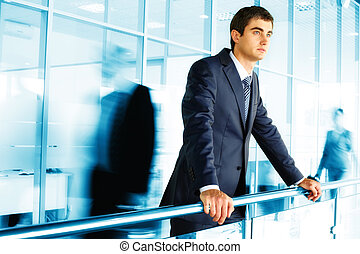 A bit of rest - Businessman standing by banisters with...