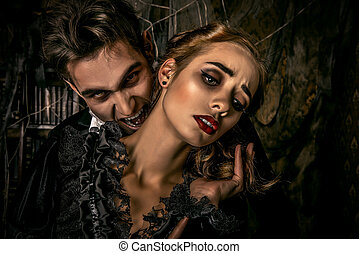 a bite of a vampire - Bloodthirsty male vampire in medieval...