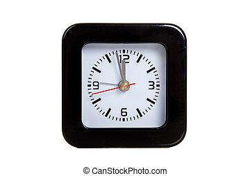 a black alarm clock on white