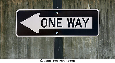 One Way - A black and white sign that reads One Way