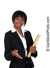 A black businesswoman about to give a handshake.