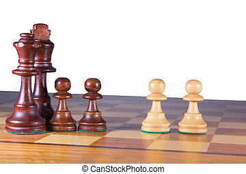 A black chessfamily fighting against two white pawns