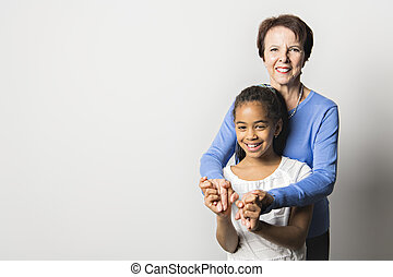 black girl child with grandmother in studio white background