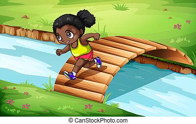 A black girl crossing the wooden bridge