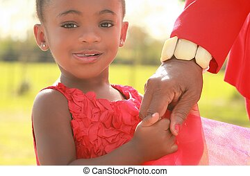 A black girl holding her granny - A black girl holding her...