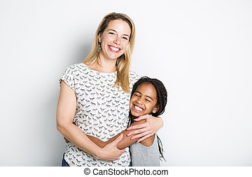 black girl with her mother, isolated on gray background